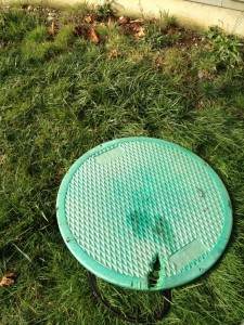 This is a common problem. Lid on the septic tank was damaged by a lawn mower. This damage destroys the lids structural integrity and allows Oder's to escape.